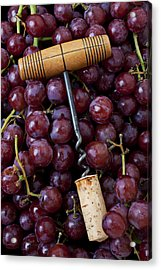Corkscrew And Wine Cork On Red Grapes Acrylic Print by Garry Gay