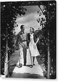 Couple Outdoors Holding Hands While Walking Acrylic Print by George Marks