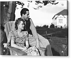 Couple Relaxing On Deckchair In Garden, (b&w) Acrylic Print by George Marks