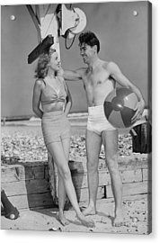 Couple Standing On Beach, Talking, (b&w) Acrylic Print by George Marks