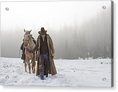 Cowboy Walking His Horse And Holding A Shotgun Acrylic Print by Thomas Kokta