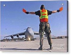 Crew Chief Marshals A C-5 Galaxy Acrylic Print by Stocktrek Images