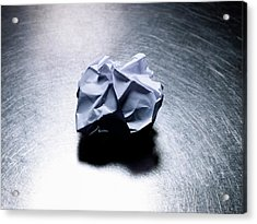 Crumpled Sheet Of White Paper On Stainless Steel. Acrylic Print by Ballyscanlon