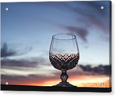 Crystal Glass Against Sunset Acrylic Print by Blink Images