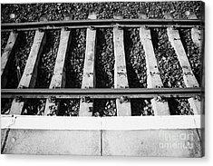 Edge Of Railway Station Platform And Track Northern Ireland Uk Acrylic Print by Joe Fox