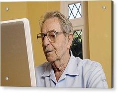 Elderly Man Using A Laptop Computer Acrylic Print by Steve Horrell