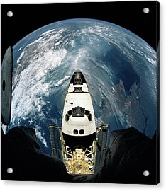 Elevated View Of A Spacecraft Orbiting Over The Earth Acrylic Print by Stockbyte