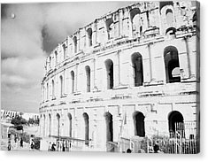 Entrance And Front Of The The Old Roman Colloseum Against Blue Cloudy Sky El Jem Tunisia Acrylic Print by Joe Fox