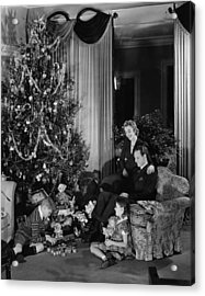 Family With Two Children (6-9) Sitting At Christmas Tree, (b&w) Acrylic Print by George Marks