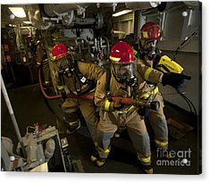 Firemen Combat A Simulated Fire Aboard Acrylic Print by Stocktrek Images