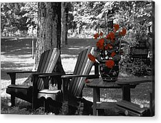 Garden Chairs With Red Flowers In A Pot Acrylic Print by David Chapman