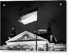 german flag flying fluttering on flagpole outside reichstag building Berlin Germany Acrylic Print by Joe Fox
