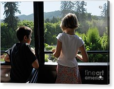 Girl And Boy Looking Out Of Train Window Acrylic Print by Sami Sarkis