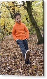 Girl Kicking Leaves Acrylic Print by Ian Boddy
