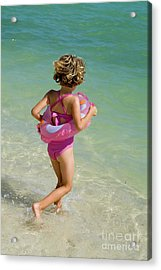 Girl Running Into Water On Beach Acrylic Print by Sami Sarkis