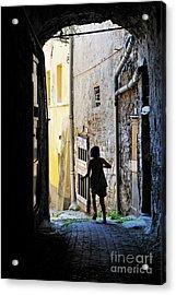 Girl Running Through A Cobblestone Street Acrylic Print by Sami Sarkis