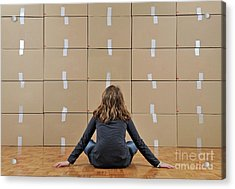 Girl Seated In Front Of Cardboard Boxes Acrylic Print by Sami Sarkis
