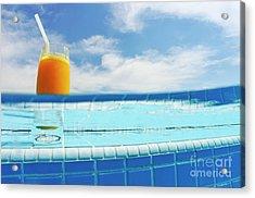 Glass Of Orange Juice On Pool Ledge Acrylic Print by Sami Sarkis