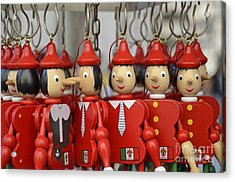 Hanging Pinocchios Puppets Acrylic Print by Sami Sarkis