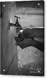 Hispanic Man Cupping Water And Washing Hands At Outdoor Tap Acrylic Print by Joe Fox