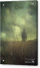 Hooded Man Walking In Field With Storm Clouds Acrylic Print by Sandra Cunningham