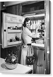 House Wife Removing Milk From Refrigerator Acrylic Print by George Marks