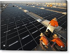 Installing Photovoltaic Panels Acrylic Print by Michael Melford