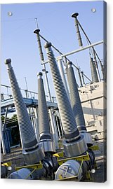 Insulators At Electricity Substation Acrylic Print by Mark Williamson