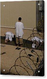 Islamic Detainees Pray At Camp Delta Acrylic Print by Everett