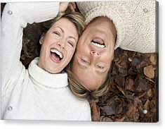 Laughing Couple Lying On Autumn Leaves Acrylic Print by Ian Boddy