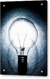 Light Bulb On Stainless Steel Background. Acrylic Print by Ballyscanlon