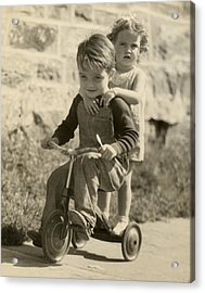 Little Boy Giving Little Girl Ride On Tricycle Acrylic Print by George Marks