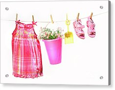 Little Girl Clothes And Toys On A Clothesline Acrylic Print by Sandra Cunningham