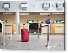 Luggage At An Airline Check-in Counter Acrylic Print by Jaak Nilson