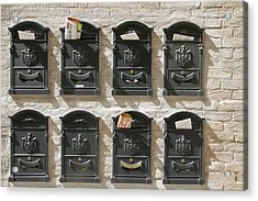 Mailboxes Lined On A Stone Wall Acrylic Print by Gina Martin