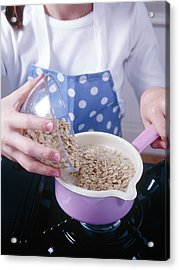 Making Porridge From Oats Acrylic Print by Veronique Leplat