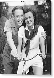 Man Embracing Woman Sitting On Bike, (b&w), Portrait Acrylic Print by George Marks