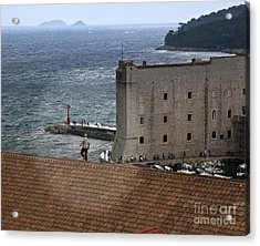 Man On The Roof In Dubrovnik Acrylic Print by Madeline Ellis