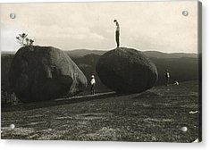Man Stands Atop A Huge Boulder On Bald Acrylic Print by Herbert E. Gregory