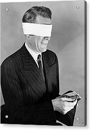 Man Wearing Blindfold Holding Money (b&w) Acrylic Print by Hulton Archive