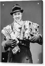 Man With Coat, Gloves And Hat Carrying Christmas Gifts Acrylic Print by George Marks