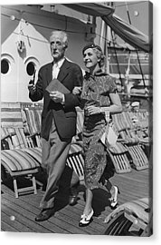 Mature Couple On Deck Of Boat Acrylic Print by George Marks