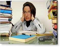 Mature Office Worker Sitting At Desk With Piles Of Folders Acrylic Print by Sami Sarkis