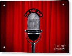 Microphone On Stage With Spotlight On Red Curtain Acrylic Print by Richard Thomas