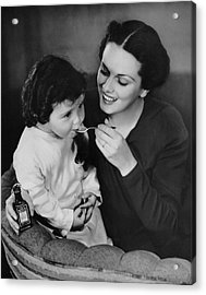 Mother Giving Spoon Of Medicine To Child Acrylic Print by George Marks