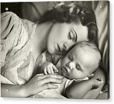 Mother Holding Infant In Bed Acrylic Print by George Marks