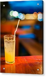 Orange Juice On Table Wilth Color Of Light Acrylic Print by Kittipan Boonsopit