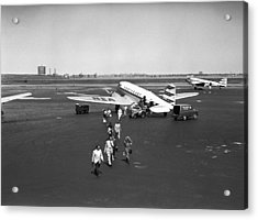 People Walking On Runway, (b&w), Elevated View Acrylic Print by George Marks