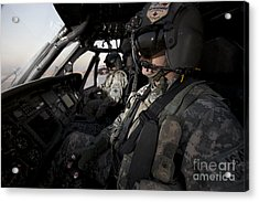 Pilot In The Cockpit Of A Uh-60l Acrylic Print by Terry Moore