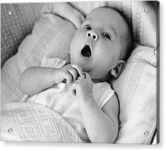 Portrait Of Baby Yawning Under Blankets Acrylic Print by George Marks